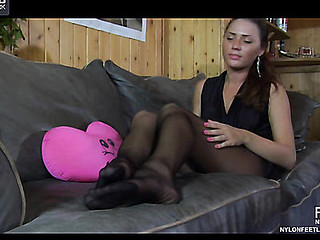 Shenythia massaging her nylon feet