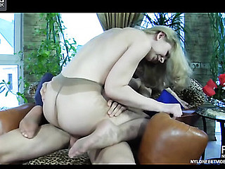 Hot golden-haired lets a guy smack her pantyhosed feet in advance of jumping onto his rod