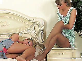 Helga&Trinity nylon footfuck movie scene