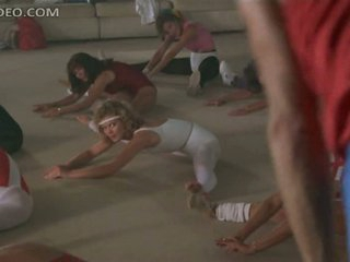 Breathtaking Retro Blonde Sheree Wilson Exercising In a Tight Appliance