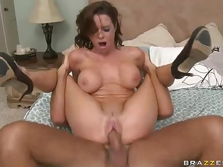 Big breasted cougar Veronica Avluv calls for technician to fix her computer and her pussy too. She sucks big cock with her pink blouse on and then rides it naked in the middle of the bed.