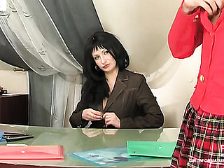 Stockinged aged gal taking out her large strap-on to stretch a youthful vagina