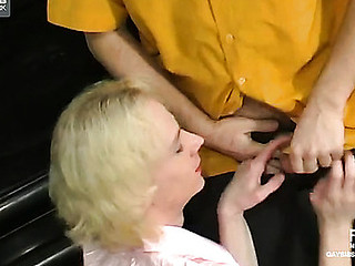 Golden-haired sissy in a pink skirt and a matching blouse enjoys rimjob in the presence of close by anal