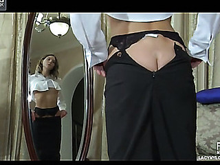 Leggy hotty takes off her silky robe to attach a garter to her darksome nylons