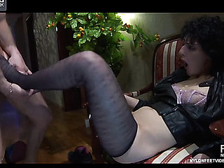 Funky gal gets her nyloned feet serviced by a stud lusting for her wet twat