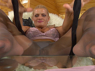 Masturbating blond settles be incumbent on darker crotchless hose smeared in her spirits