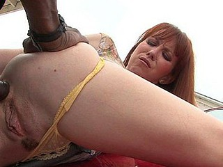 Trinity Post is one horny redhead who knows her way around studs.  That Babe seizes Rock's thick weenie and heads to town orally gratifying him previous to getting on all fours and sticking her ass up in the air for some deep dick penetration.