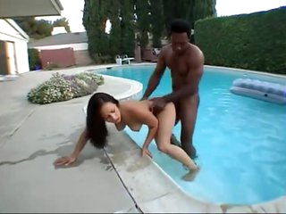 Hottie and her black paramour in the backyard