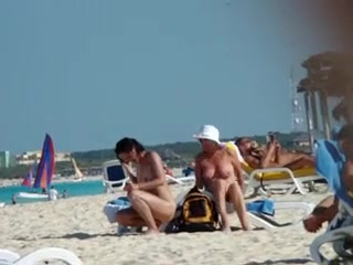 Naked aged wife receives a stranger to rub sun lotion on her back, tiny boobs and little hair visible.