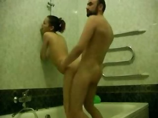 Bearded man washes his sexy girlfriend in bathroom, soaping her sweet hole and then disrobes to fuck her right there.