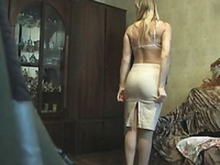 This blonde fem was late so she didn't have time to look around or even think that there could be a voyeur with the cam in her room when she put on her white lacy brassiere and beige skirt