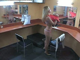 This make-up room is empty if we forget about the spy camera like this lewd blonde did. She disregarded the livecam and smoked sitting half naked on the table and then walking around absolutely naked!