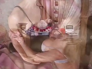 Two horny golden-haired in stockings receive in bed and scissor permanent