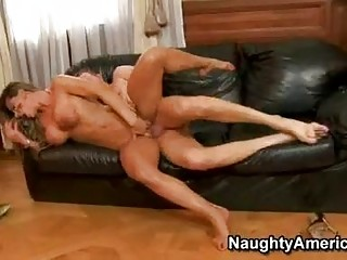 Tanned blonde with massive hooters acquires her muff rammed on couch
