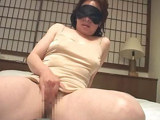 Married old Asian granny is blindfolded as this honey masturbates her censored pussy