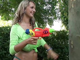 The 2 breasty golden-haired babes Jannete & Carol went outside for playing in the hot weather & got one another's T-shirts soaked with squirt-guns. During their little lesbian game their pussies got soaked also, so they had to get absolutely naked to show