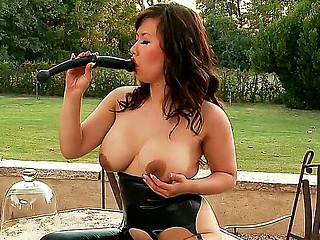 Busty Asian slut Tigerr Benson shows her huge scoops and masturbates with a black toy