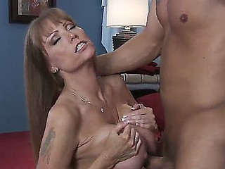 Danny Mountain is pleased to have sexy milf Darla Krane sucking his rigid jock