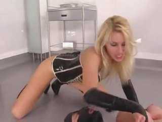 Latex fetish porn with sexy blond and her submissive