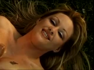 Blonde with big knockers doing tit fuck outdoors