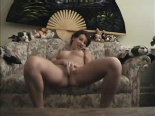 Short hair generalized insusceptible to a webcam playing adjacent to her body