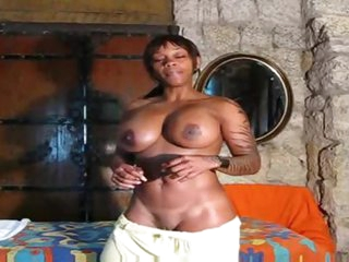 Fit black gal postures solo and talks to you