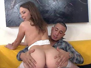 Lily Love is a naughty brown haired lady in white