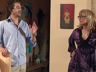 Nina Hartley is s good looking aged blonde with big