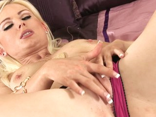 Wonderful blond Alexis Jade with slick pussy and natural tits bares her assets after posing in lingerie and masturbates. She rubs her snatch with her fingers and takes vibrator.