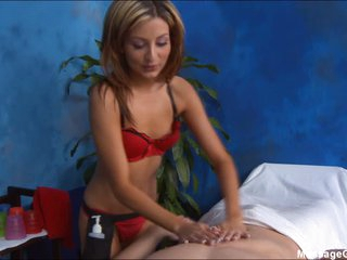 Diminutive masseuse in red Lexi D