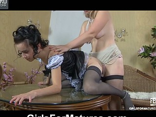 Cute French maid fulfills lesbian kinks of will not hear of older strap-on armed bit of all right