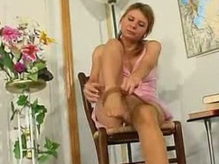 Bouncy gal stroking herself with nylon hands longing to give pantyhosejob