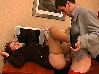 Salacious secretary in silky hose knows the superlatively good way of lunch break