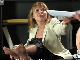 Sex-starving secretary seducing her boss with tasty feet in shiny hose