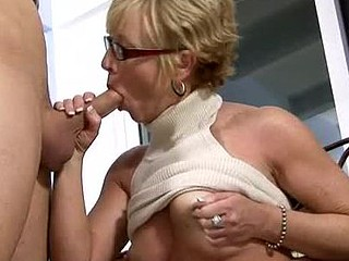Sexy mother i'd like to fuck in glasses sucks and copulates her chap toy