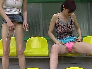 Girls peeing in the straps at the stadium