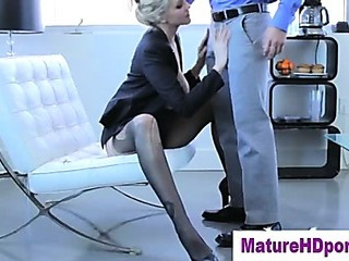 Blonde cougar uses toy in her muff