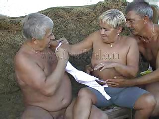 Those 2 old farts where looking in a porn magazine when granny Heidrun caught them. As long they were all there they've began fucking and formed a threesome. The granny was undressed by the old men and they've started to grope her boobs and massage her saggy cunt. Will they fill her with semen?