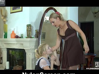 Blond maid in white stockings gags on a strap-on and takes it up her snatch