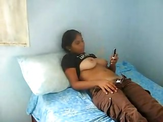 A very big boob indian teen girl lets me make a movie as she texts a friend while her top is rolled up and she puss down her panties and panties revealing her hairy crotch