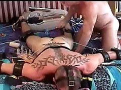 Muscular dude is bound and face down while I pound his balls and then turn him over and pound more.